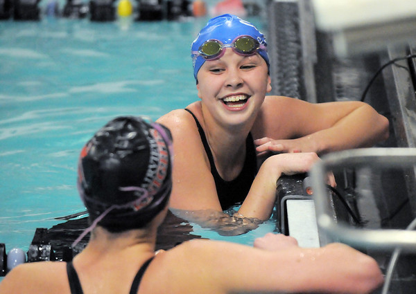 Broomfield's Heather Shaver talks with Fairview's Kourtne Fosse after  swimming in the 100 yard breaststroke during the Coaches Invitational Swim Meet at Mountain View Aquatic Center in Loveland on Saturday.<br /> <br /> Gail Davies<br /> <br /> December 18, 2010<br /> staff photo/David R. Jennings