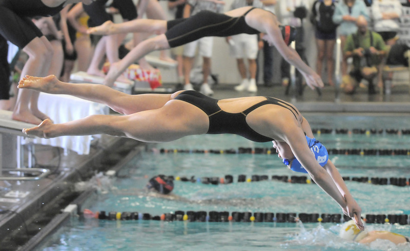 Broomfield's Abi Young launches off the blocks during the 200 yard medley relay at the 4A state championship swim meet at Mountain View High School in Loveland on Saturday.<br /> February 12, 2011 <br /> staff photo/David R. Jennings