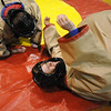 Teachers Heidi VanDePol, right, and Kristen Bushaw laugh after they fell while Sumo wrestling during the Teach Olympics competition at Broomfield High School on Wednesday.<br /> .<br /> <br /> <br /> November 4, 2009<br /> Staff photo/David R. Jennings