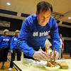 Craig Boccard, assistant principal, tries to stack various foods as high as possible during the Teach Olympics competition at Broomfield High School on Wednesday.<br /> .<br /> <br /> <br /> November 4, 2009<br /> Staff photo/David R. Jennings
