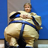 Athletic Director John Long takes a rest in a Sumo wrestling outfit during the Teach Olympics competition at Broomfield High School on Wednesday.<br /> .<br /> <br /> <br /> November 4, 2009<br /> Staff photo/David R. Jennings