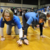 Teachers Stephanie Zechmann, left, and Jill Johnson crawl while tied together during the Teach Olympics competition at Broomfield High School on Wednesday.<br /> .<br /> <br /> November 4, 2009<br /> Staff photo/David R. Jennings