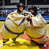 Teachers Kristen Bushaw, left, and Heidi VanDePol try their best at  Sumo wrestling during the Teach Olympics competition at Broomfield High School on Wednesday.<br /> .<br /> <br /> November 4, 2009<br /> Staff photo/David R. Jennings