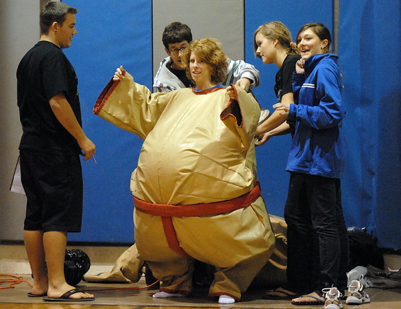 Teacher Heidi VanDePol puts on a Sumo wrestling outfit with help from students at the Teach Olympics competition at Broomfield High School on Wednesday.<br /> .<br /> <br /> November 4, 2009<br /> Staff photo/David R. Jennings