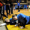 Teachers Stephanie Zechmann, left, and Jill Johnson laugh as they cross the finish line while tied together and crawling during the Teach Olympics competition at Broomfield High School on Wednesday.<br /> .<br /> <br /> <br /> November 4, 2009<br /> Staff photo/David R. Jennings