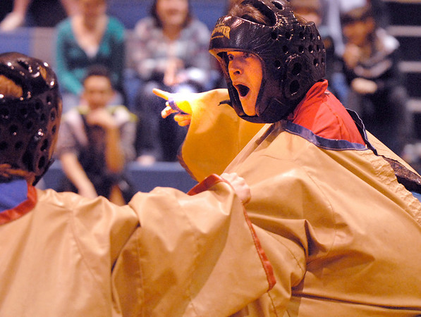 Heidi VanDePol and Kristen Bushaw, right, joke with each other while Sumo wrestling at the Teach Olympics competition at Broomfield High School.<br /> <br /> <br /> October 30, 2009<br /> Staff photo/David R. Jennings