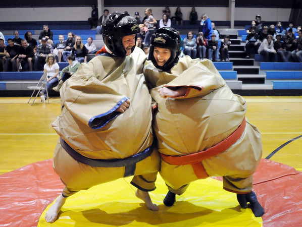 Teachers Kevin Stirling, left, Sumo wrestles Kailen Eichhorn during the Teach Olympics competition at Broomfield High School on Wednesday.<br /> .<br /> <br /> <br /> November 4, 2009<br /> Staff photo/David R. Jennings
