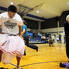 Teacher's Garren Estes, left, and Sam Martin try to put on silly cloths during the Teach Olympics competition at Broomfield High School on Wednesday.<br /> .<br /> <br /> <br /> November 4, 2009<br /> Staff photo/David R. Jennings