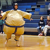 Athletic Director John Long skips across the gym floor while wearing a Sumo wrestling outfit during the Teach Olympics competition at Broomfield High School on Wednesday.<br /> .<br /> <br /> <br /> November 4, 2009<br /> Staff photo/David R. Jennings