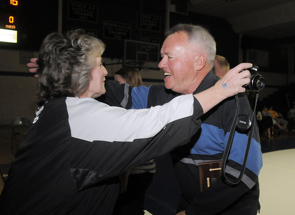"Jim Wilpolt the Eagle's 1963, 133 lb. state champion hugs Renee Kozisek-Sereff after being honored with other Broomfield High state wrestling champions  on Thursday at Broomfield.<br /> For more photos please see  <a href=""http://www.broomfieldenterprise.com"">http://www.broomfieldenterprise.com</a><br /> January 19, 2012<br /> staff photo/ David R. Jennings"