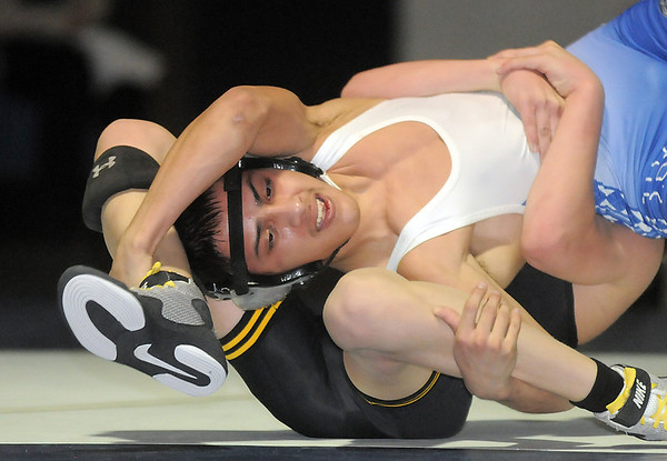 """Broomfield's Drew Romero wrestles Thompson Valley's Collin Williams in the 106 lb. weight class during Thursday's match at Broomfield.<br /> For more photos please see  <a href=""""http://www.broomfieldenterprise.com"""">http://www.broomfieldenterprise.com</a><br /> January 19, 2012<br /> staff photo/ David R. Jennings"""