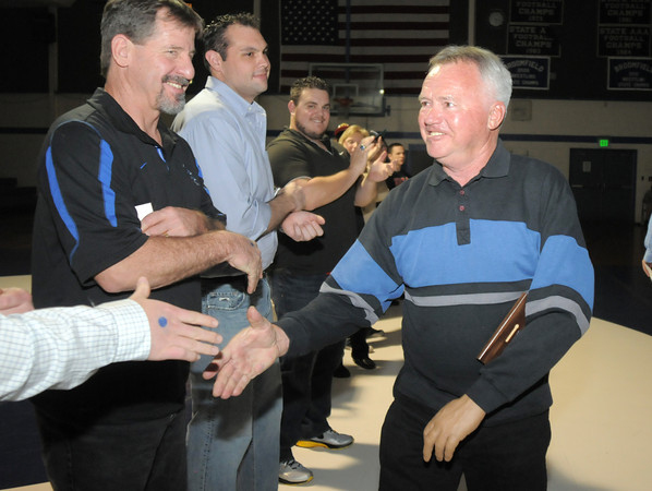 "Jim Wilpolt the Eagle's 1963, 133 lb. state champion shakes the hands of other Broomfield High state wrestling champions  being honored on Thursday at Broomfield.<br /> For more photos please see  <a href=""http://www.broomfieldenterprise.com"">http://www.broomfieldenterprise.com</a><br /> January 19, 2012<br /> staff photo/ David R. Jennings"