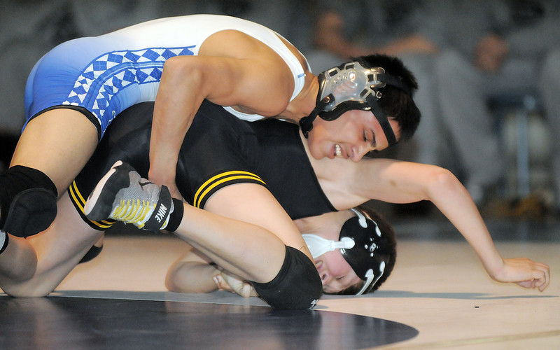 "Broomfield's Drew Romero wrestles Thompson Valley's Collin Williams in the 106 lb. weight class during Thursday's match at Broomfield.<br /> For more photos please see  <a href=""http://www.broomfieldenterprise.com"">http://www.broomfieldenterprise.com</a><br /> January 19, 2012<br /> staff photo/ David R. Jennings"