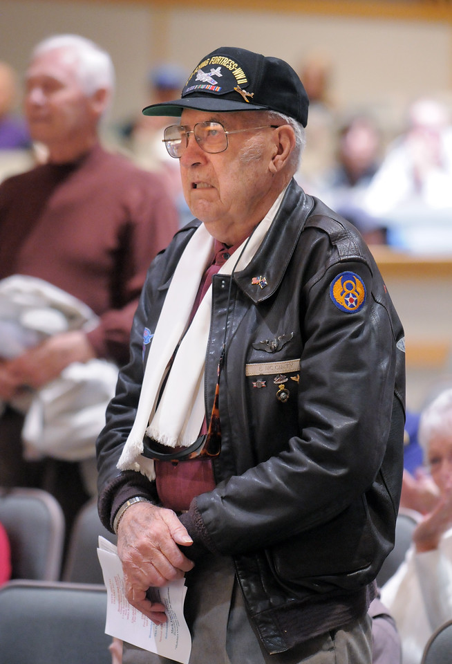 Lucky McGinty, a World War II veteran who flew in B-17 bombers in the 8th Air Force, stands to be recognized  for his service during the Veterans Day Observance sponsored by the Broomfield Veterans Memorial Museum at Broomfield High School on Thursday.<br /> November 11, 2010<br /> staff photo/David R. Jennings