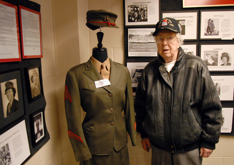Irish Brophy, 91, poses with her U.S. Marine uniform on display at the Broomfield Veterans Memorial Museum during the Veterans Day Observance sponsored by the at Broomfield High School on Thursday.<br /> November 11, 2010<br /> staff photo/David R. Jennings