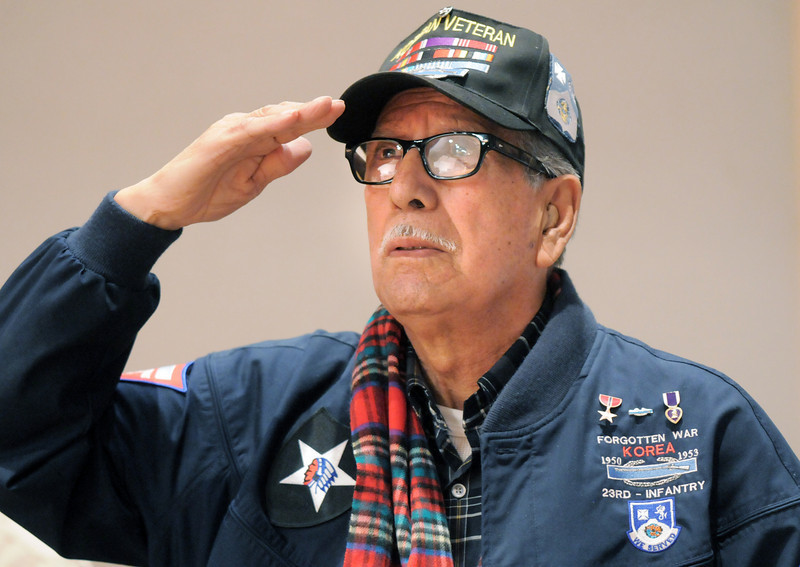 Korean War veteran Lou Barrientos salutes while Taps was played during the Veterans Day Observance sponsored by the Broomfield Veterans Memorial Museum at Broomfield High School on Thursday.<br /> November 11, 2010<br /> staff photo/David R. Jennings