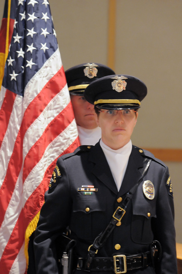 Broomfield Police Honor Guard lead by officer Carol Lucero waits to present the flag during the Veterans Day Observance sponsored by the Broomfield Veterans Memorial Museum at Broomfield High School on Thursday.<br /> November 11, 2010<br /> staff photo/David R. Jennings