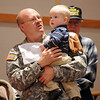 SSG. Hap Fertig, holds his son Jonah, 17, months-old, during the ceremomies at the Sixth Annual Veteran's Day Obervance at Broomfield High School on Wednesday.<br /> <br /> November 11, 2009<br /> Staff photo/David R. Jennings