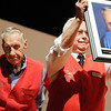 Bob Seeber, right, holds a portrait of Vic Boccard, left, that will hang at the Broomfield Veteran's Museum during the ceremomies at the Sixth Annual Veteran's Day Obervance at Broomfield High School on Wednesday.  Boccard is one of the founding members of the museum.<br /> <br /> November 11, 2009<br /> Staff photo/David R. Jennings