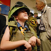 James Hall, 7, tries on Vietnam War battle gear at the Broomfield Veteran's Museum on Wednesday.<br /> <br /> November 11, 2009<br /> Staff photo/David R. Jennings