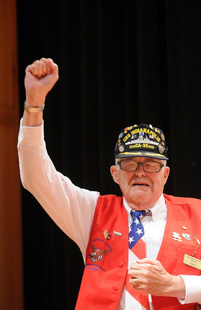 Paul Murphy, World War II Navy veteran and survivor of the sinking of the USS Indianapolis, raises his arm as the US Navy song is sung during the ceremomies at the Sixth Annual Veteran's Day Obervance at Broomfield High School on Wednesday.<br /> <br /> November 11, 2009<br /> Staff photo/David R. Jennings