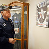 Lou Barrientos, Korean War Vetran, looks at a display of  pictures he donated to Broomfield Veteran's Museum on Wednesday.<br /> <br /> November 11, 2009<br /> Staff photo/David R. Jennings