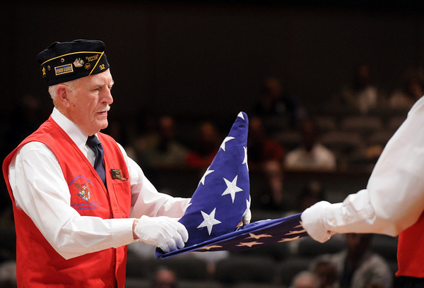 Wayne Burt, left, with Jim Sparks, demonstrates the 13-folds of the flag during the ceremomies at the Sixth Annual Veteran's Day Obervance at Broomfield High School on Wednesday.<br /> <br /> November 11, 2009<br /> Staff photo/David R. Jennings