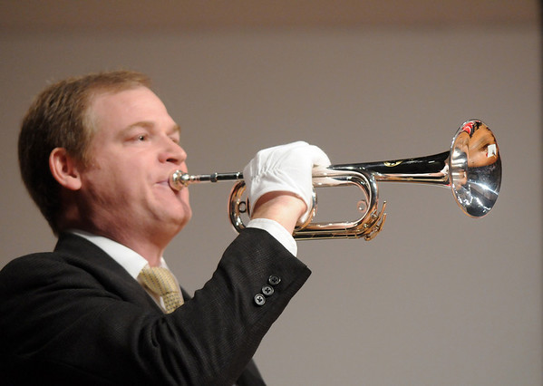 David Burkhardt  plays Taps at the closing ceremomies of the Sixth Annual Veteran's Day Obervance at Broomfield High School on Wednesday.<br /> <br /> November 11, 2009<br /> Staff photo/David R. Jennings