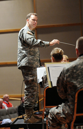SSG Nathaniel Johnson directs the Colorado National Guard 101st Army Band during the ceremomies at the Sixth Annual Veteran's Day Obervance at Broomfield High School on Wednesday.<br /> <br /> November 11, 2009<br /> Staff photo/David R. Jennings