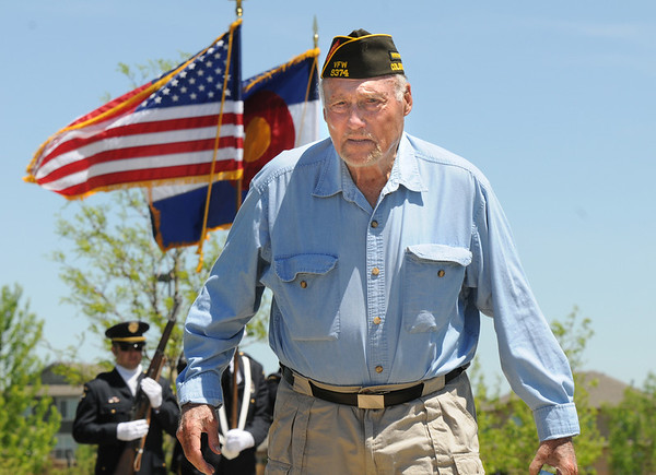 John Greaves, WWII Marine veteran, walks back to his chair after photographing the Broomfield Police HOnor Guard at the beginning of  the Broomfield Veterans Memorial Museum's Memorial Day Picnic on Monday at the Broomfield County Commons Park .<br /> May 31, 2010<br /> Staff photo/ David R. Jennings