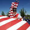 Jim Sparks rolls up flags after the Broomfield Veterans Memorial Museum's Memorial Day Picnic on Monday at the Broomfield County Commons Park .<br /> May 31, 2010<br /> Staff photo/ David R. Jennings