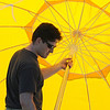 Matthew Zotter puts up a yellow umbrella for shade during the Broomfield Veterans Memorial Museum's Memorial Day Picnic on Monday at the Broomfield County Commons Park .<br /> May 31, 2010<br /> Staff photo/ David R. Jennings