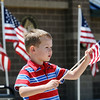 Hayden Bailey, 3, carries a flag during the Broomfield Veterans Memorial Museum's Memorial Day Picnic on Monday at the Broomfield County Commons Park .<br /> May 31, 2010<br /> Staff photo/ David R. Jennings