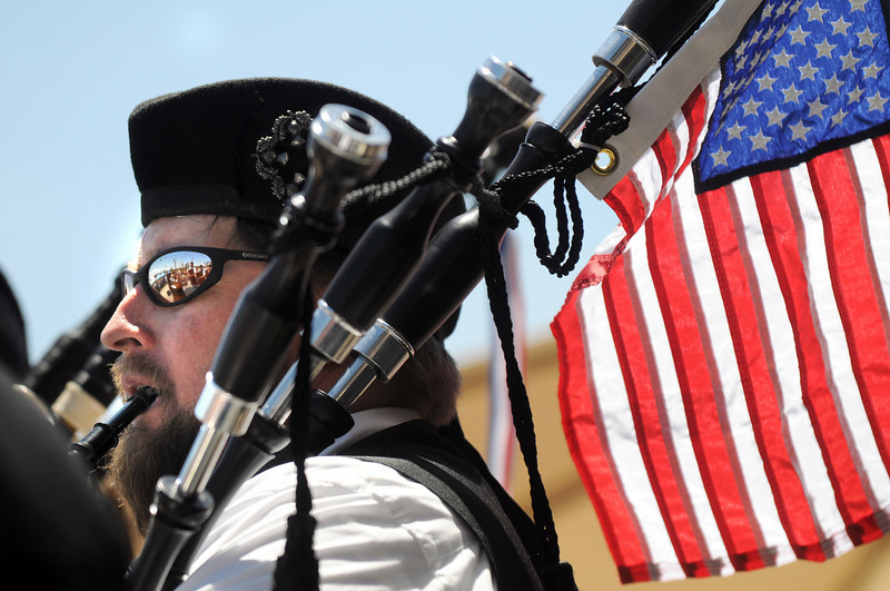 Charles Stegall plays the bag pipes for the Michale Collins Pipes and Drums during the Broomfield Veterans Memorial Museum's Memorial Day Picnic on Monday at the Broomfield County Commons Park .<br /> May 31, 2010<br /> Staff photo/ David R. Jennings