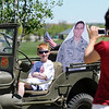 Lisa Smith takes a picture of her son Brenden with a life size photograph of her husband USAF Lt. Col. Bill Smith, who is currently serving in Iraq, in a WWII 1944 Ford GPW during the Broomfield Veterans Memorial Museum's Memorial Day Picnic on Monday at the Broomfield County Commons Park . Lisa Smith, from Parker, and her family, carry her husband's picture around and takes pictures with the photograph at various events, including a graduation, so he can see where he's been when he returns from Iraq. <br /> May 31, 2010<br /> Staff photo/ David R. Jennings