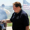 Jim Kautz cooks hamburgers for the Broomfield Lions Club during the Broomfield Veterans Memorial Museum's Memorial Day Picnic on Monday at the Broomfield County Commons Park .<br /> May 31, 2010<br /> Staff photo/ David R. Jennings