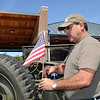 Ray Fernandez puts a flag on his WWII Ford GPW on display at the Broomfield Veterans Memorial Museum's Memorial Day Picnic on Monday at the Broomfield County Commons Park .<br /> May 31, 2010<br /> Staff photo/ David R. Jennings