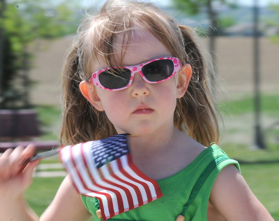 Lorna Gail Heil, 3, carries a small US flag during the Broomfield Veterans Memorial Museum's Memorial Day Picnic on Monday at the Broomfield County Commons Park .<br /> May 31, 2010<br /> Staff photo/ David R. Jennings
