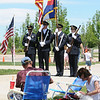 The Broomfield Police Honor Guard prepare to march as people picnic  during the Broomfield Veterans Memorial Museum's Memorial Day Picnic on Monday at the Broomfield County Commons Park .<br /> May 31, 2010<br /> Staff photo/ David R. Jennings