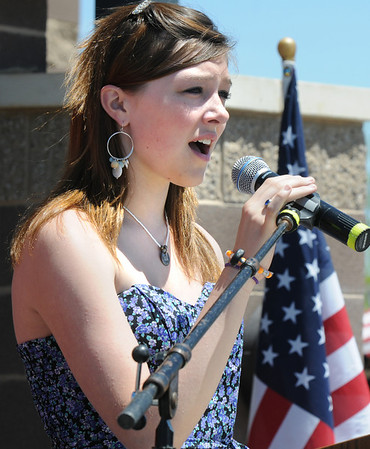 Abby Kochevar sings the national anthem during the Broomfield Veterans Memorial Museum's Memorial Day Picnic on Monday at the Broomfield County Commons Park .<br /> May 31, 2010<br /> Staff photo/ David R. Jennings
