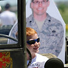 While sitting in a WWII Ford GPW, Brenden Smith, 8,  poses for a picture with a life size photograph of his father USAF Lt. Col. Bill Smith, who is currently serving in Iraq,  during the Broomfield Veterans Memorial Museum's Memorial Day Picnic on Monday at the Broomfield County Commons Park . Lisa Smith, from Parker, and her family, carry her husband's picture around and takes pictures with the photograph at various events including a graduation so he can see where he's been when he returns from Iraq. <br /> May 31, 2010<br /> Staff photo/ David R. Jennings