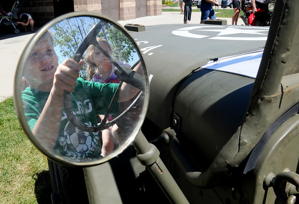 "Ryan Collins, 7, ""drives"" the WWII Ford GPW on display during the Broomfield Veterans Memorial Museum's Memorial Day Picnic on Monday at the Broomfield County Commons Park .<br /> May 31, 2010<br /> Staff photo/ David R. Jennings"