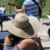 A woman listens to a band  play during the Broomfield Veterans Memorial Museum's Memorial Day Picnic on Monday at the Broomfield County Commons Park .<br /> May 31, 2010<br /> Staff photo/ David R. Jennings