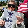 Ann Enlow, 89, holds a US flag and a Coast Guard flag during the Broomfield Veterans Memorial Museum annual Memorial Day Picnic at the Broomfield County Commons. Enlow served in the Coast Guard's SPARS during World War II.<br /> May 28, 2012 <br /> staff photo/ David R. Jennings