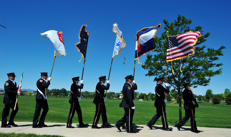 The combined honor guard of the Broomfied Police and North Metro Fire marches off after presenting the colors during the Broomfield Veterans Memorial Museum annual Memorial Day Picnic at the Broomfield County Commons.<br /> May 28, 2012 <br /> staff photo/ David R. Jennings