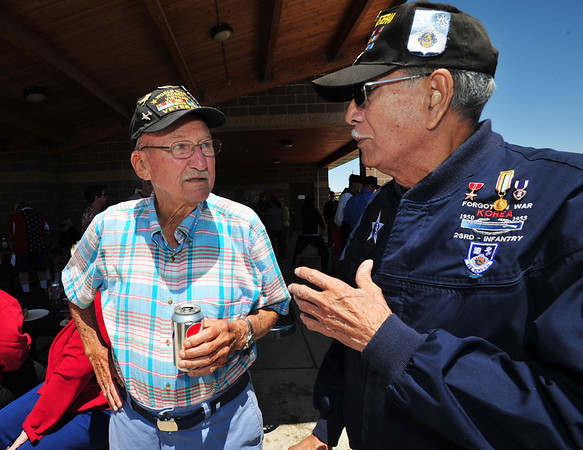 Korean War veterans John Kramer, US Air Force, left, and Lou Barrientos, US Army, share stories during the Broomfield Veterans Memorial Museum annual Memorial Day Picnic at the Broomfield County Commons.<br /> May 28, 2012 <br /> staff photo/ David R. Jennings