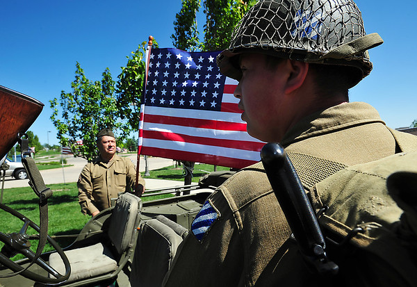 Carols Ramerez, left, and his son David, 16, set up their display for the Company B 15th Regiment, 3rd Infantry historical reenactment group during the Broomfield Veterans Memorial Museum annual Memorial Day Picnic at the Broomfield County Commons.<br /> May 28, 2012 <br /> staff photo/ David R. Jennings
