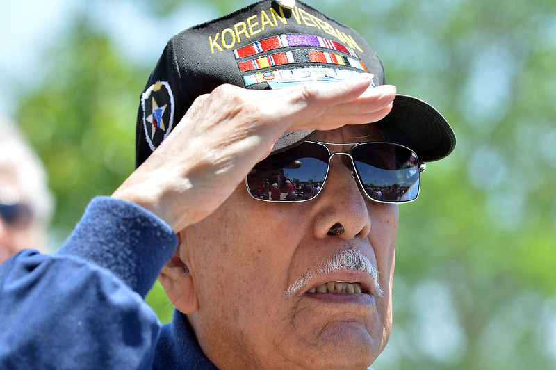 Korean War veteran Lou Barrientos salutes during the playing of TAPS at the conclusion of the Broomfield Veterans Memorial Museum annual Memorial Day Picnic at the Broomfield County Commons.<br /> May 28, 2012 <br /> staff photo/ David R. Jennings