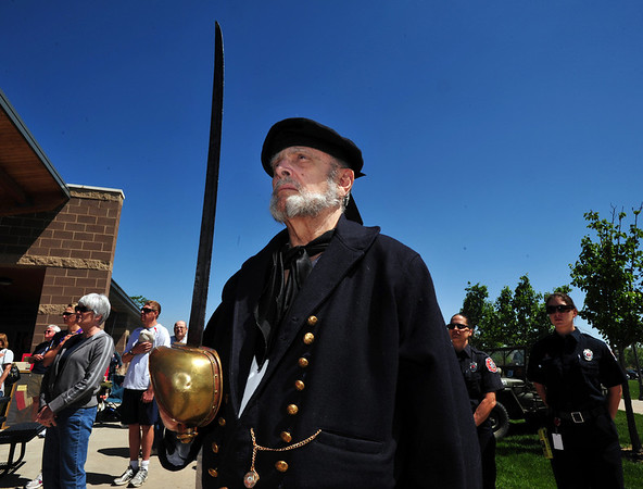 Bob Moulder gives the Civil War Navy salute during the play of the national anthem at the Broomfield Veterans Memorial Museum annual Memorial Day Picnic at the Broomfield County Commons.<br /> May 28, 2012 <br /> staff photo/ David R. Jennings