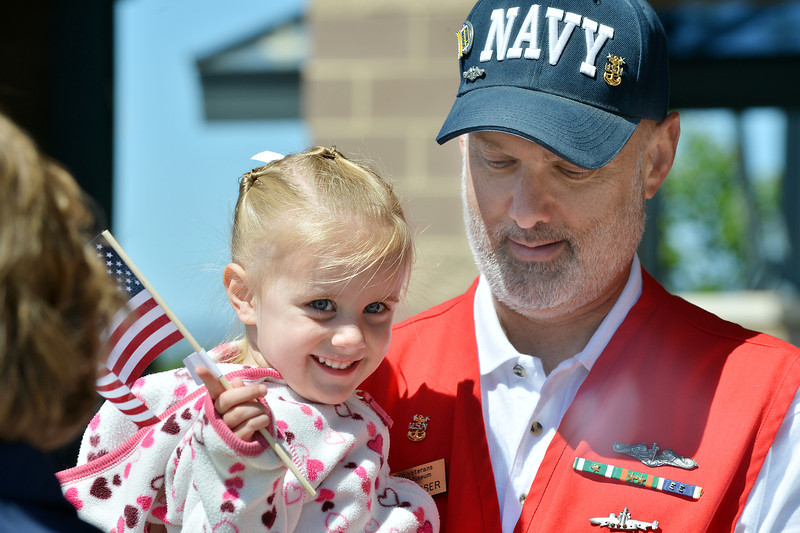 Jerry Chesser holds his grand daughter Shelby Chesser, 2, during the Broomfield Veterans Memorial Museum annual Memorial Day Picnic at the Broomfield County Commons.<br /> May 28, 2012 <br /> staff photo/ David R. Jennings